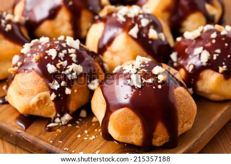 Eclairs with cream and chocolate - stock photo