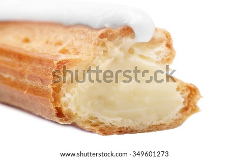 Eclairs with cream isolated on white background.