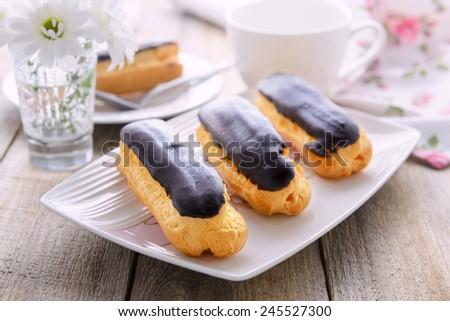 Eclairs with custard - stock photo