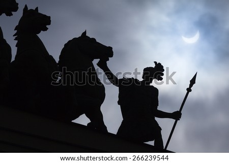 Eclipse in St. Petersburg on Palace Square - stock photo