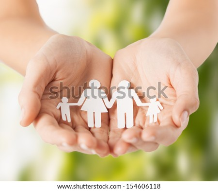 eco, bio, nature, love, harmony concept - woman cupped hands showing paper man family - stock photo