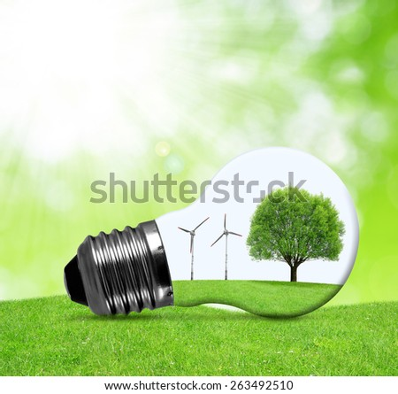 Eco bulb with wind turbines and tree. Green energy concept. - stock photo