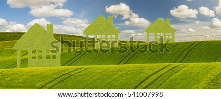 Eco concept, green house against a blue sky
