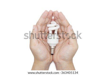 Eco concept. The hands holding bulb