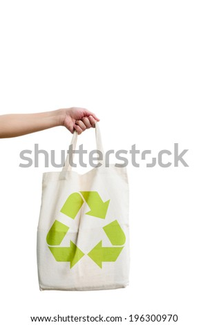 eco concept. with fabric eco bag and recycle sign icon .  Isolated on a white background.   - stock photo