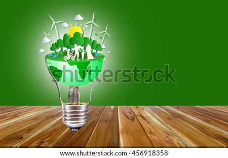 ECO energy saving concept in our world green light bulb. - stock photo