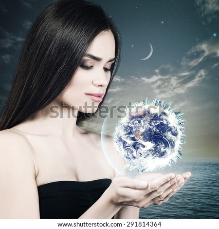 Eco female portrait with beauty white girl holding blue planet on to his palm