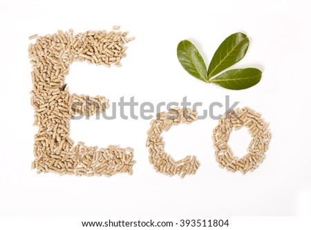 eco fonts written with wood pellets, on white background with green leaves - stock photo