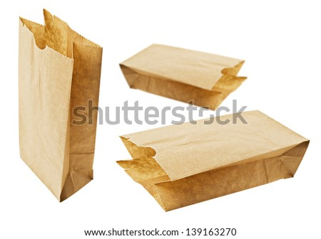 Eco friendly brown paper bags on white - stock photo