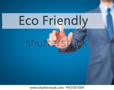 Eco Friendly - Businessman hand pressing button on touch screen interface. Business, technology, internet concept. Stock Photo - stock photo