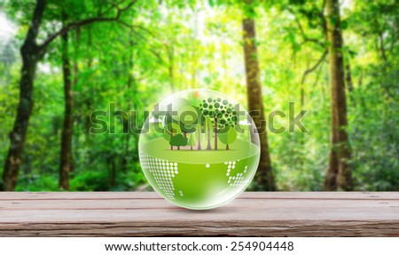 Eco friendly earth on wood table - stock photo