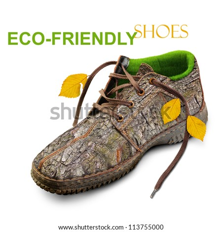 Eco-friendly shoes. Concept. Shoes made of natural materials. Winter shoes from the bark of a tree, grass and leaves. Isolated over white background. - stock photo