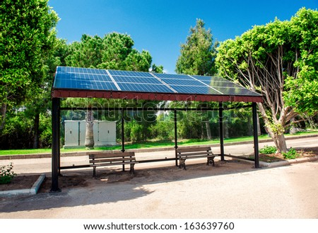 Eco-friendly solar bus stop - stock photo