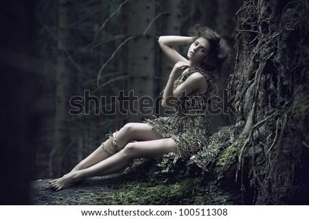 Eco girl lying on the trunk - stock photo