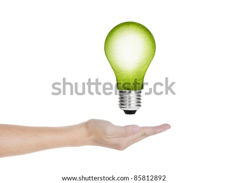 eco green energy saving in the future concept, hand holding  leaf in electric light bulb - stock photo