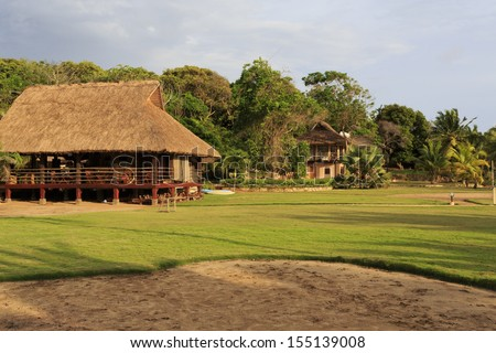 Eco hotel with thatched roof in Axim, Ghana - stock photo