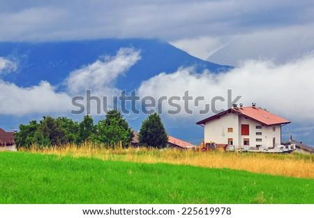 Eco house in italian village - stock photo
