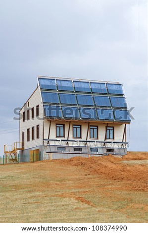 Eco-house with solar panels - stock photo