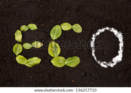 eco icon made of leaves on soil - stock photo