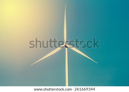 Eco power, Green energy concept. Wind turbine generator in Thailand. Vintage filter. - stock photo