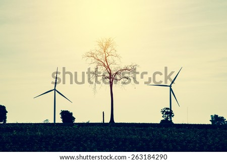 Eco power, Green energy concept. Wind turbine generator in Thailand. Vintage filter.
