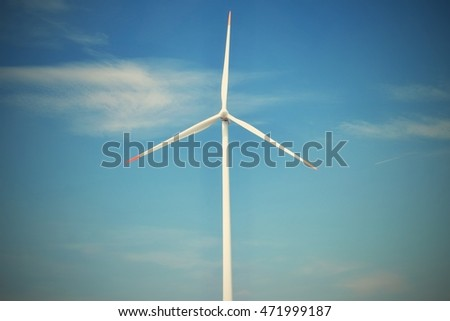 Eco power. Wind Turbine for alternative green energy.