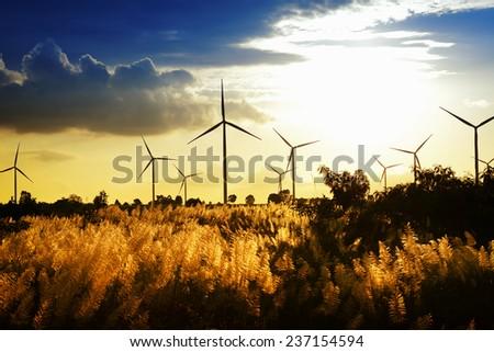 Eco power ,wind turbine power generator at twilight - stock photo