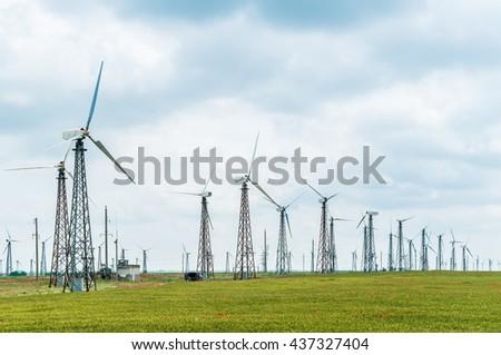 Eco power, wind turbines,   plant - stock photo