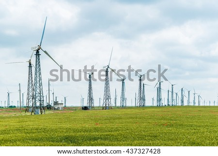 Eco power, wind turbines,   plant - stock photo