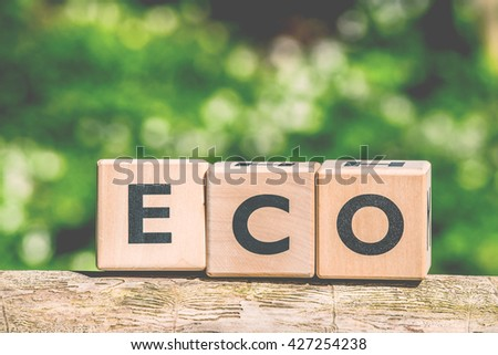 Eco sign made of wooden cubes in the forest