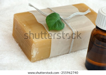 Eco soap bar and essential aroma oil.  - stock photo