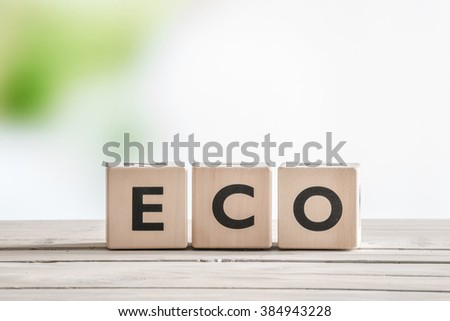 Eco word sign on wooden cubes on a table