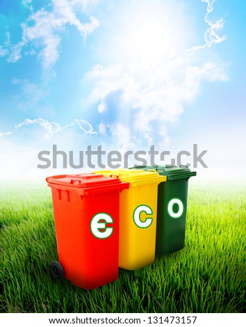 Eco wording on colorful recycle bins ecology concept with landscape background.
