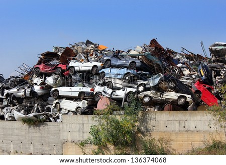 ecological concept by dump of wrecked cars - stock photo