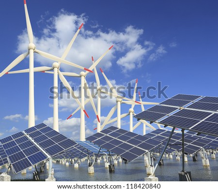 Ecological energy, fish ponds, wind power and solar generator sets - stock photo