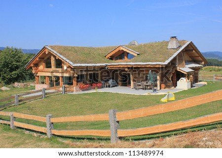Ecological house in a mountain area - stock photo