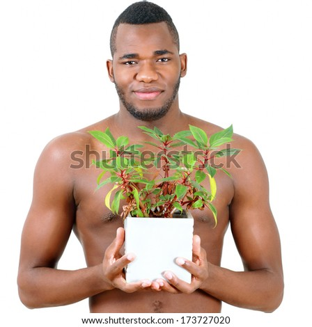 Ecological theme portrait of man with green plant - stock photo
