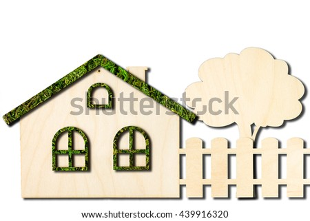 Ecological toy wooden house with the fence isolated on white background.