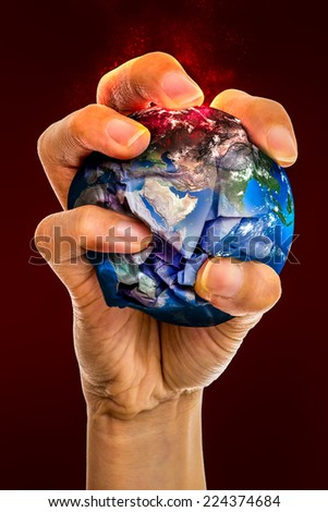 Ecology concept, holding the Earth in hands, destroying it, Elements of this image furnished by NASA - stock photo