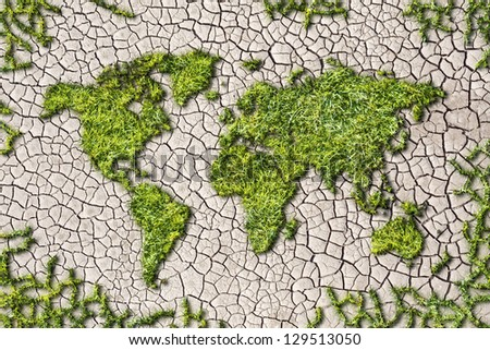 ecology world map from grass on cracked earth background - stock photo