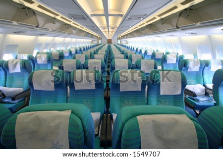 economy class seats in an airbus A340 - stock photo