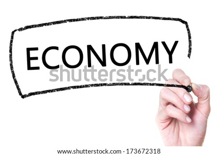 Economy handwritten on glass - stock photo