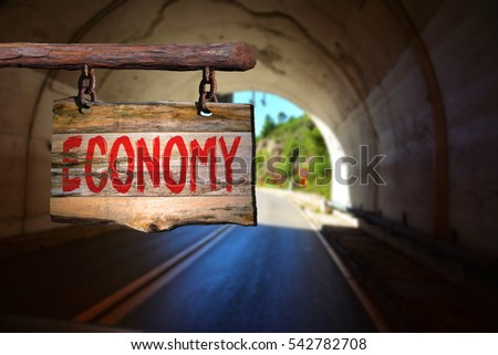 Economy motivational phrase sign on old wood with blurred background