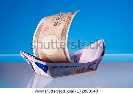 Economy Recovery Concept: Euro Sailboat being pushed by the YEN bill - stock photo