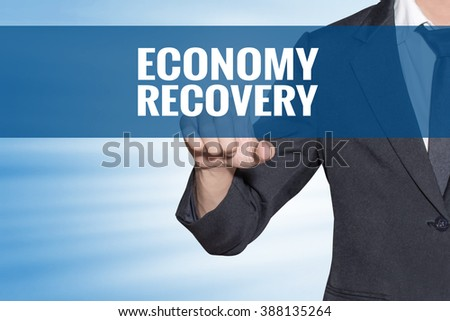 Economy Recovery word Business man touching on blue virtual screen - stock photo