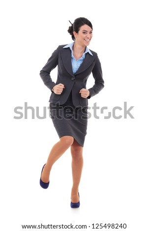 Ecstatic businesswoman in suit dancing on white background - stock photo