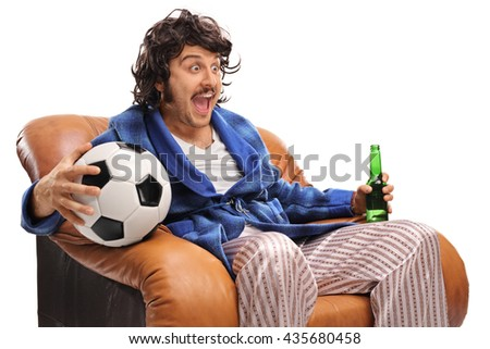 Ecstatic football fan watching a game on TV and drinking beer isolated on white background - stock photo