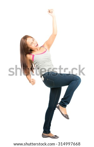 Ecstatic, good looking Asian woman in casual clothes jeans and tank top, eyes closed, screaming, celebrating and winning by raising fist thrust into the air while facing away - stock photo