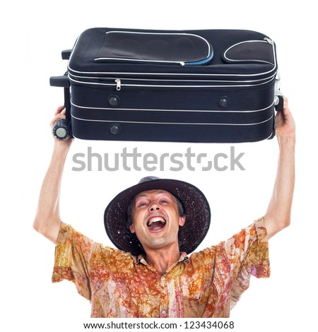Ecstatic happy man travelling with luggage, isolated on white background. - stock photo