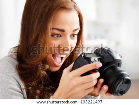 ecstatic photographer looking at photo